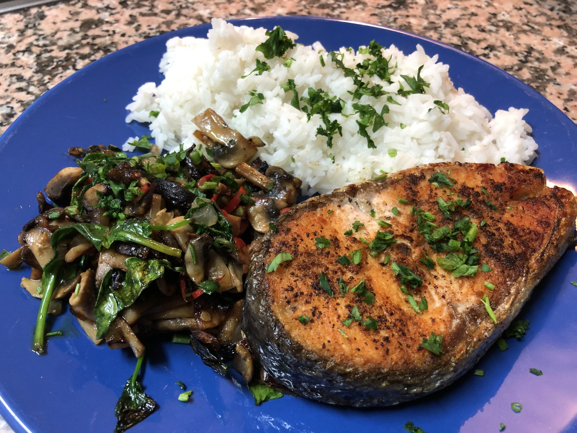 Salmon cutlet with spicy vegetables and parsley rice